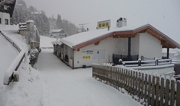 Entrance to the Classic apartments in deep snow-covered Matrei in Osttirol
